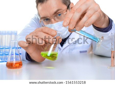 Male researcher carrying out scientific research in a lab. Close up. Focus on hands.