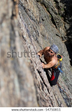Male rock-climber  on a granite wall - stock photo