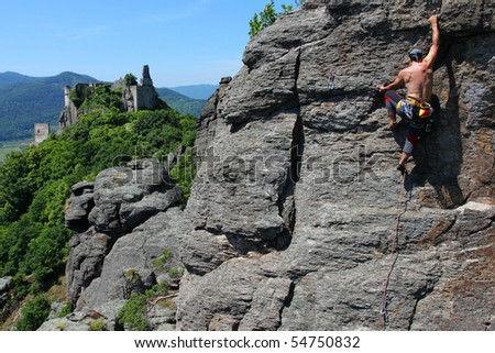 Male rock-climber  on a granite wall with magnificent view