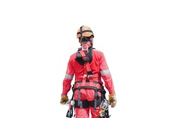 Male rope access worker wearing full safety harness clipping Karabiner into harness loop prior to abseiling working at height construction site isolated on white background clipping paths.