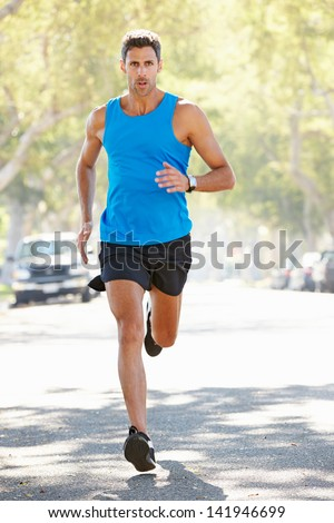 Male Runner Exercising On Suburban Street