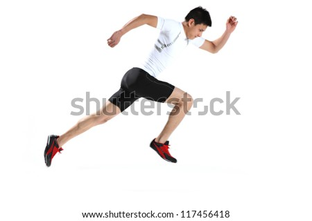 Male runner in starting blocks