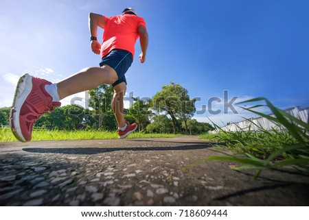 male runner jogging during outdoor workout -  running man #718609444