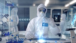 Male Scientist analyzing and interacting with a 3D Rotating DNA Molecule Hologram in a Secure High Level Modern Laboratory. Genetic Engineering Research Facility.