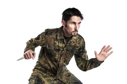 Male self defense instructor with camouflage do a self defense exercise with knife, isolated on white background
