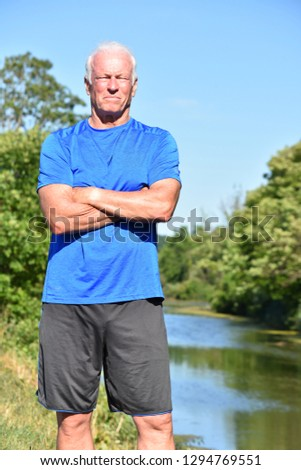 Male Senior And Muscles Outdoors