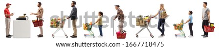 Male shop assistant at a cash register and a queue of people shopping food isolated on white background