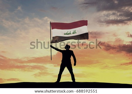 Male silhouette figure waving Iraq flag. 3D Rendering