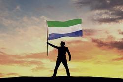 Male silhouette figure waving Sierra Leone flag. 3D Rendering
