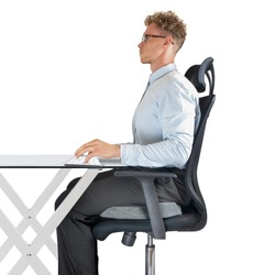 Male sitting on office chair at desk with good posture and support