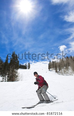 Male Skier laughing while enjoying his ski vacation