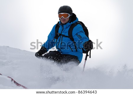 Male skier skiing back country