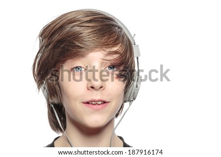 male smiling teenager with headphones, isolated on white.