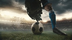 Male soccer, football player catching ball in playing during sport match on sky background at stadium with flashlights. Sport competition. Action, motion, energy and dynamic concept.