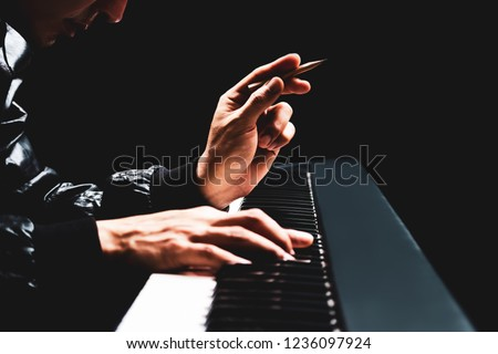 male songwriter hands composing a song on piano, song writing concept #1236097924