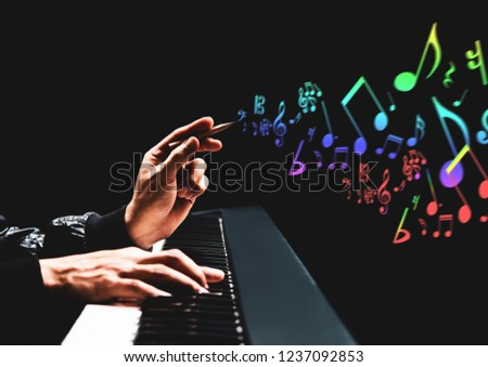 male songwriter hands composing a song on piano. song writing, music education concept #1237092853