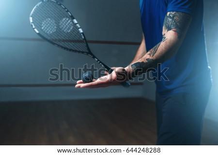 Male squash player training on indoor court ストックフォト ©