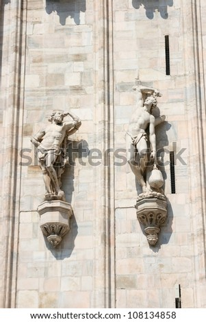 Male statues at the exterior wall of Milan Duomo, Milan, Italy