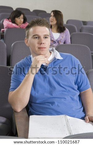 Male student concentrating - stock photo