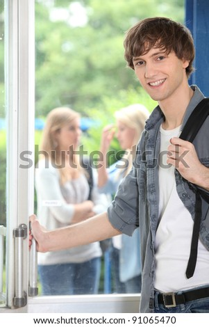 Male student on campus - stock photo