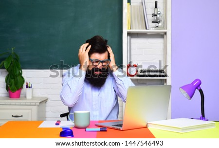 Male student over green chalkboard background. Teachers day. Young serious student. Male student thinks about coursework in university. Teacher in classroom. Students and tutoring education concept.