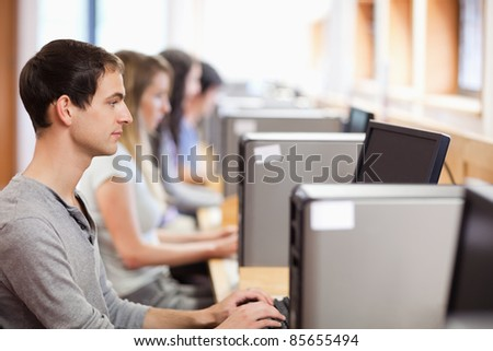 Male student using a computer in an IT room