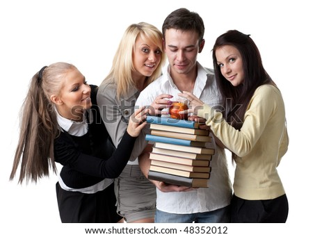 Male student with books and an apple among beautiful female students.