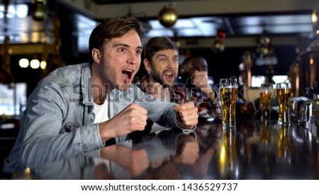 Male supporters watching sport program in bar celebrating victory, true men rest