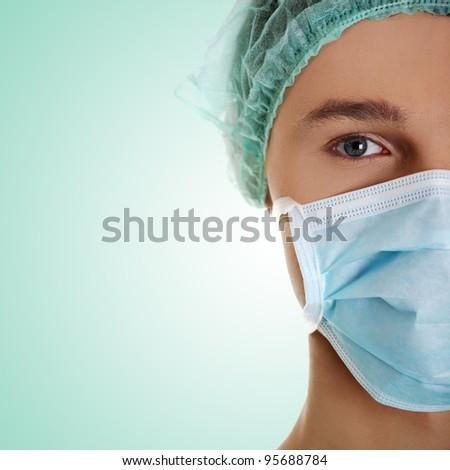 Male surgeon looking at camera at hospital, close up shot