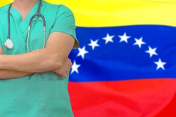 Male surgeon or doctor with stethoscope on the background of the Venezuela flag. Health care and medical concept. Surgery concept in Venezuela.