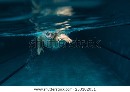 Male swimmer at the swimming pool.Underwater photo. #250102051