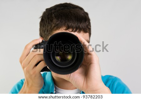 Male taking pictures with a DSLR camera