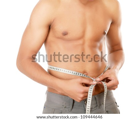 Male tanned torso with measure tape isolated on white background