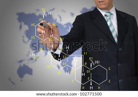 Male Teacher write science formula