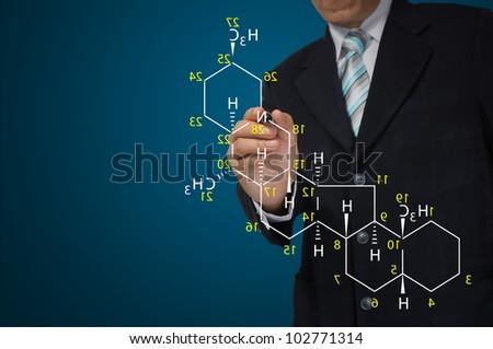 Male Teacher write science formula on blue background