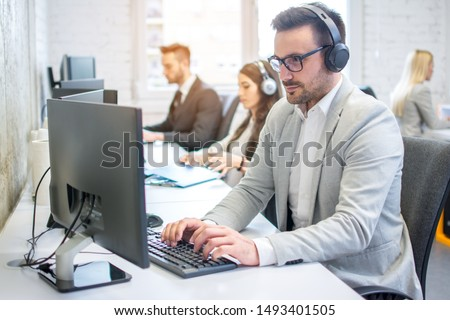 Male technical support dispatcher in call center