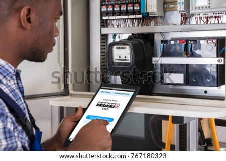 Male Technician Doing Meter Reading Using Tablet