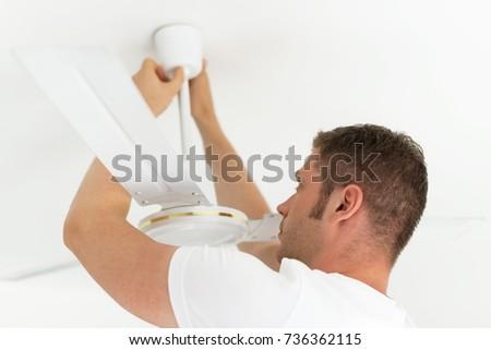 Male technician installing ceiling fan. #736362115
