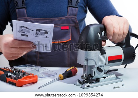 Male technician reads the manual instruction.Repair concept, small business.