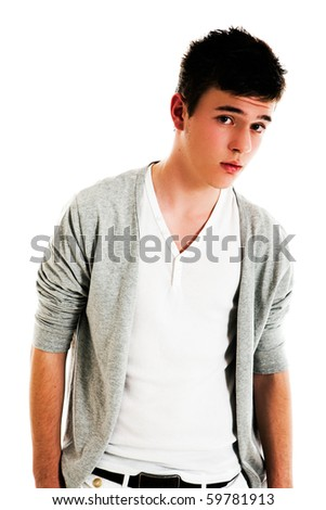 stock photo : Male teen with an open sweater looks towards the camera with a ...