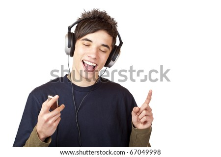 Male Teenager with headphones listening to music and sings happy. Isolated on white background.