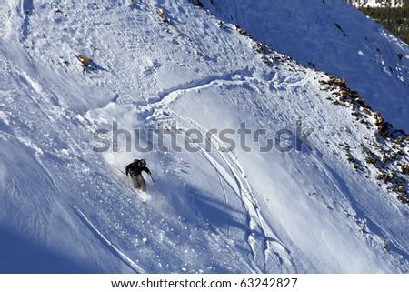 Male Telemark Skier on a steep run