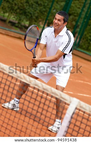 Male tennis player waiting for a service