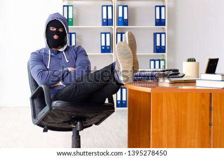 Male thief in balaclava in the office  #1395278450