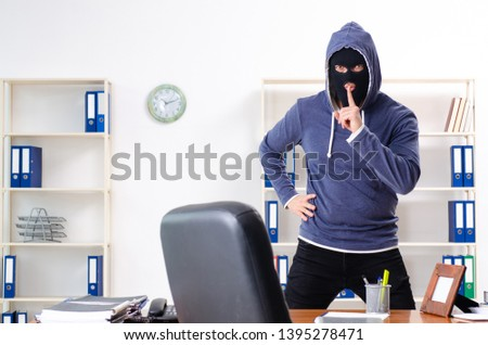 Male thief in balaclava in the office  #1395278471