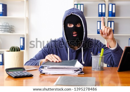 Male thief in balaclava in the office  #1395278486