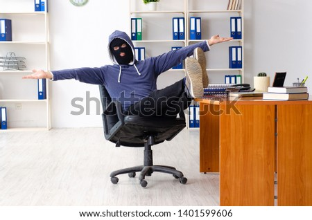 Male thief in balaclava in the office  #1401599606