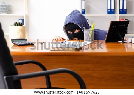 Male thief in balaclava in the office  #1401599627