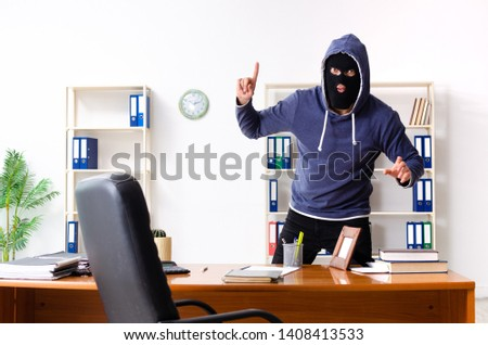 Male thief in balaclava in the office  #1408413533