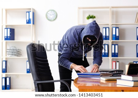 Male thief in balaclava in the office  #1413403451
